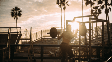 20 Powerful Quotes To Inspire You To Get Healthy featured image of man lifting in stadium