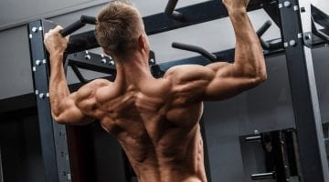 Man strength training in his home gym