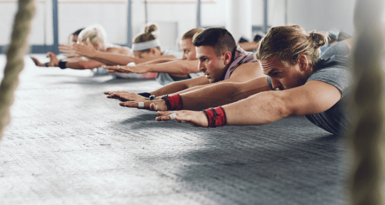Group of men and women training to become superhuman