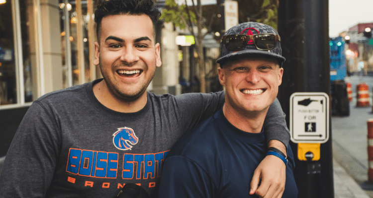 Two guys became friends at a ball game